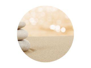 Balance zen stones in sand on white