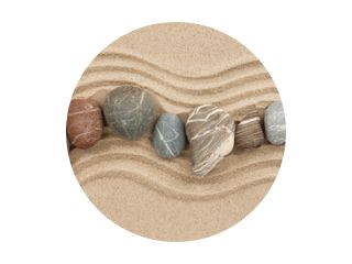 Striped stones on the sand