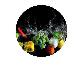 Vegetables splash in water