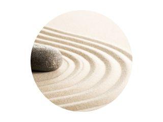 Zen stones in the sand. Grey background