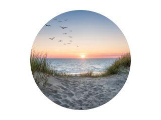 Sand dunes on the beach at sunset